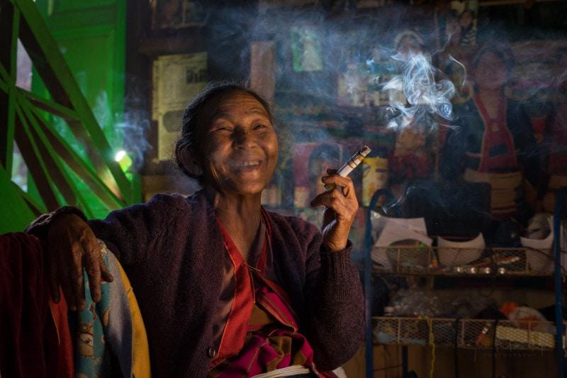 Old Shan woman smoking cigar