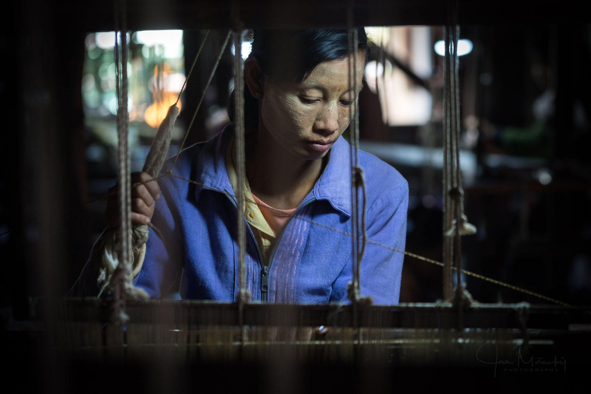 Woman working in weaving manufacture