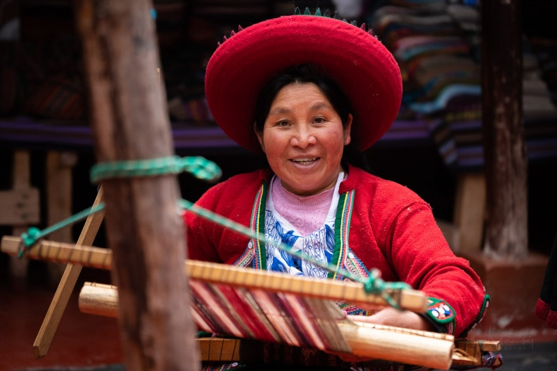 Peruvian woman at textile shop in Chinchero