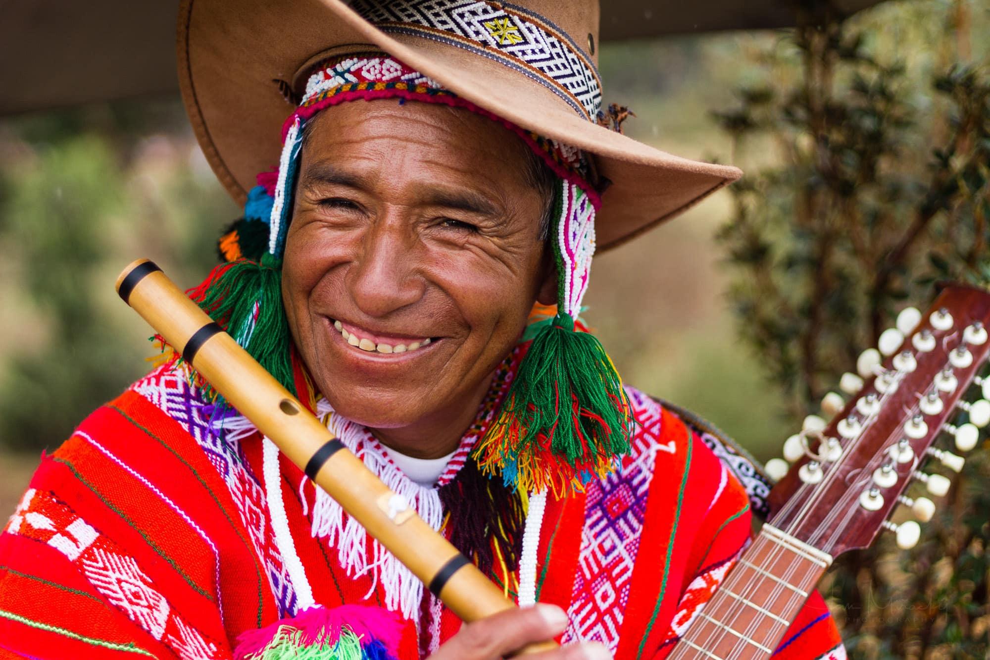 Peruvian musician plying flute and charangon