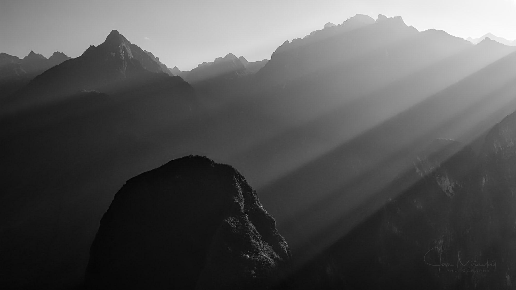 Morning sunbeams illuminating hills around Machu Picchu